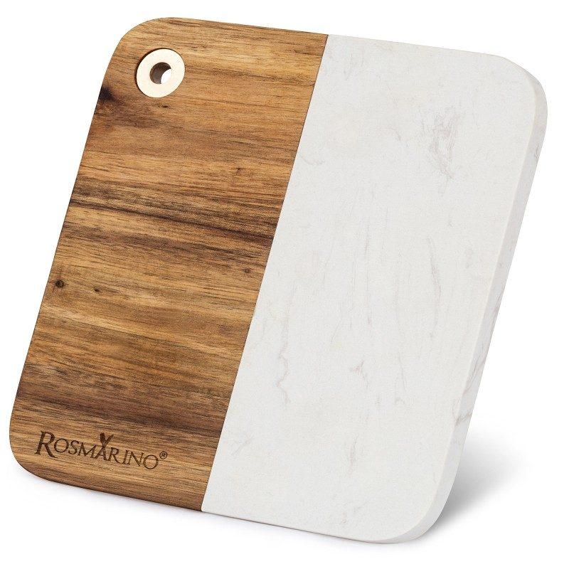 Deska za rezanje iz kombinacije akacijevega lesa in marmorja. Moderen dizajn, ki bo dal vaši kuhinji čudovit izgled. V dimenzijah 22 x 19,5 x 1,4 cm.