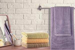 Za popolno kopalnico: Kako izbrati najboljšo brisačo?